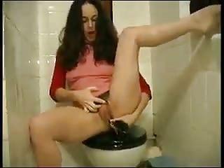 Hairy Squirting Milf Fucks Herself With Her Hair Brush